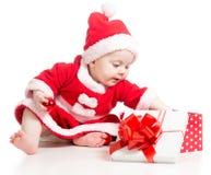 Santa Claus baby girl opening gift box Royalty Free Stock Photo