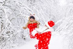 Santa claus with baby kid in a winter forest royalty free stock photo