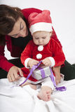 Santa claus baby and mom opening gift Stock Photography