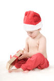 Santa claus baby in studio in christmas time Royalty Free Stock Photo