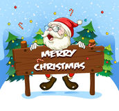Santa Claus at the back of a wooden signboard Royalty Free Stock Images