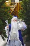 Santa Claus on the background of fir. Santa Claus in a blue suit on the background of fir Royalty Free Stock Photos