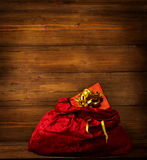 Santa Claus Bag, Christmas Red Sackful, Brown Wooden Background Stock Photos