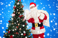 Santa claus with bag and christmas tree Stock Photo