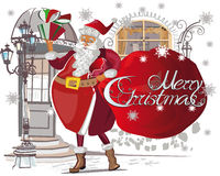 Santa Claus with a bag full of gifts near the door. Royalty Free Stock Photography