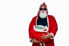 Santa Claus with bag full of money Royalty Free Stock Photos