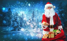 Santa Claus with a bag full of presents royalty free stock photo