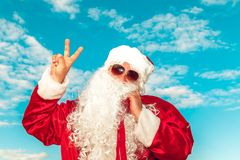 Santa Claus with a bag of gifts on the beach. Royalty Free Stock Images