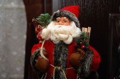 Santa Claus with a bag of gifts. Christmas figurine. Royalty Free Stock Photos
