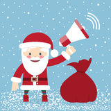 Santa Claus with a bag of gifts and holding a megaphone Stock Images