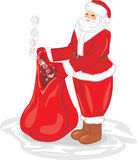 Santa Claus with a bag of gifts Stock Photo