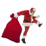 Santa Claus with a bag of gifts. Large steps running in the New Year Stock Photography