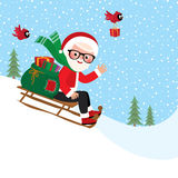Santa Claus with a bag of gifts on sledge Stock Images