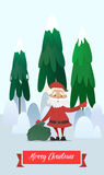 Santa Claus with a bag of gifts waving. Royalty Free Stock Photography