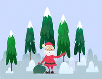 Santa Claus with a bag of gifts waving. Stock Image