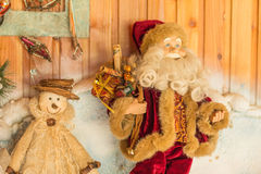 Santa Claus with a bag of gifts. Santa Claus with a bag of gifts worth at snowman Royalty Free Stock Image
