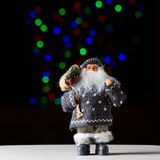 Santa Claus with bag of presents on the black background Stock Photos