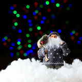 Santa Claus with bag of presents on the black background Stock Image