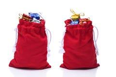Santa Claus Bags met verpakt wordt gevuld die stelt voor stock afbeeldingen