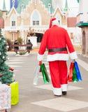 Santa Claus With Bags Walking In-Binnenplaats royalty-vrije stock fotografie