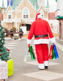 Santa Claus With Bags Walking In Courtyard Royalty Free Stock Photography