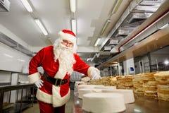 Santa Claus bakes a pie on Christmas Day. Stock Photo
