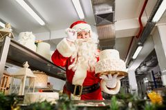 Santa Claus bakes a pie in the kitchen on Christmas Day Royalty Free Stock Image