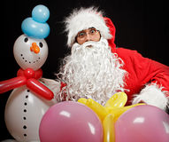 Santa claus with balloon gifts Royalty Free Stock Image