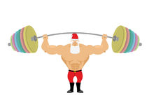 Santa Claus and barbell. Bench press barbell above his head. Exe Royalty Free Stock Photos