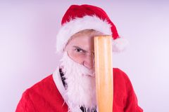 Santa Claus with a baseball bat, the concept of an evil Santa Claus for Christmas royalty free stock image