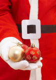 Santa claus with baubles. Santa claus with christmas baubles, shallow dof Stock Photos