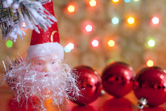 Santa claus and baubles in christmas Royalty Free Stock Photos