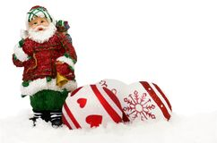 Santa claus and baubles in snow Royalty Free Stock Image