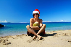Santa Claus on beach. With coconut, enjoying summer stock images