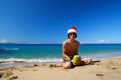 Santa Claus on beach. With coconut royalty free stock photo
