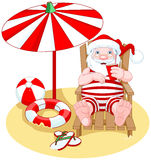 Santa Claus on the Beach. Cartoon Santa Claus relaxes on the beach Stock Image