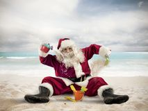Santa claus on the beach. Santa Claus enjoys playing on the beach royalty free stock images