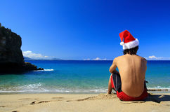 Santa Claus from on beach of ocean Royalty Free Stock Images