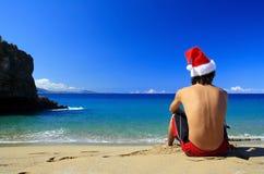 Santa Claus from on beach of ocean. Santa Claus from the back on beach of ocean royalty free stock images
