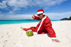 Santa Claus on beach relaxing Royalty Free Stock Images