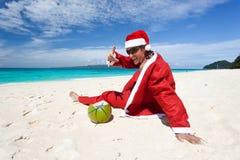Santa Claus on beach relaxing. Enjoying summer royalty free stock images