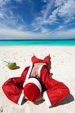 Santa Claus on beach relaxing. Enjoing summer stock photos