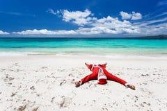Santa Claus on beach. Relaxing, enjoying summer stock photo