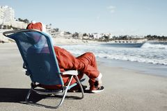 Santa claus on the beach Stock Photo