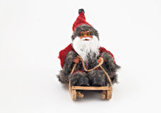 Santa Claus with a beard on a sled tree toy isolated royalty free stock image