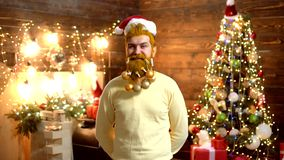 Santa Claus - bearded hipster. New year fashion clothes. Man New Year eve. Bearded crazy man looking at the camera. Santa in home. Handsome stylish bearded man stock video footage