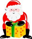 Santa Claus bearing a gift Royalty Free Stock Image