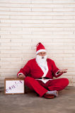 Santa Claus begging Stock Images