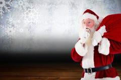 Santa claus being quiet Stock Image