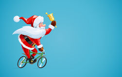 Santa claus with bell at bicycle. Christmas cartoon character. Royalty Free Stock Images
